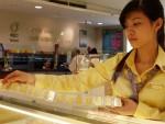 Giá vàng đồng loạt đi xuống, tỷ giá trung tâm tăng 4 đồng một USD