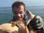 Rắn biển tử chiến đến chết với cá đá gai độc