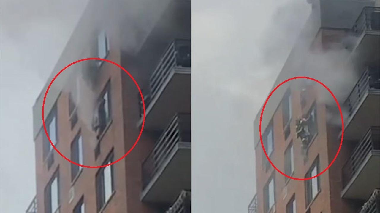 Cháy nhà, người phụ nữ bám ở cửa sổ tầng 16