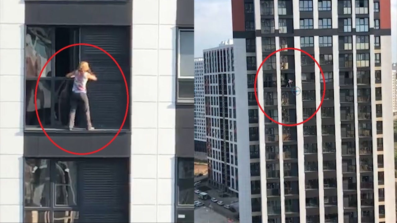 Người phụ nữ liều lĩnh trèo ra ban công tầng 17 để lau cửa sổ ở Nga